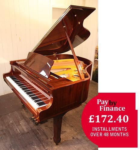 Steinhoven GP160  grand Piano for sale with a walnut case.