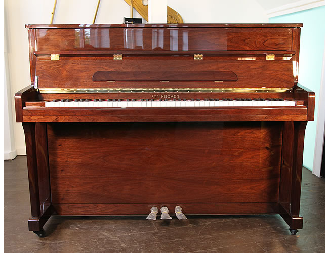 A brand new Steinhoven UP113 upright piano with a mahogany case and polyester finish