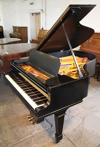 A 1901, Steinway Model A grand piano with a satin, black case and spade legs.
