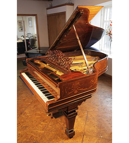 A 1900, Steinway Model A grand piano with a rosewood case. Cabinet inlaid with satinwood stringing, swags and scrolls