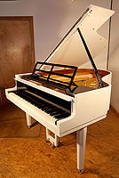 Artcase, Steinway Model M   grand piano with a black and white case, designed by Swedish Architect Ivar Tengbom. Piano has facetted octagonal legs and minimal geometric piano lyre