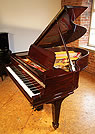 Piano for sale. A Steinway Model O grand piano with a rosewood case.
