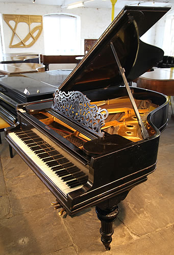 A 1905, Steinway Model O grand piano with an ebonised case and carved, turned legs