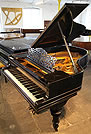 A 1905, Steinway Model A grand piano with an ebonised case and carved, turned legs