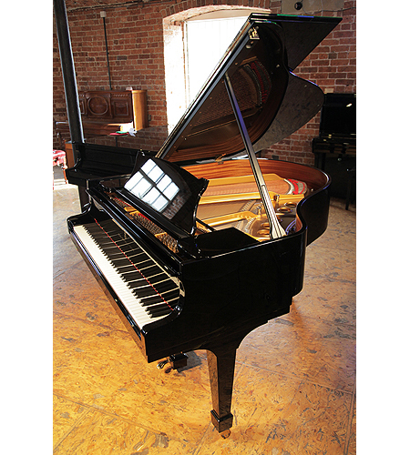 A 2004, Steinway Model S baby grand piano with a black case and fitted lifesaver system