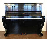 Piano for sale. A preowned, 1905 Steinway vertegrand upright piano with a  black case and etched panels