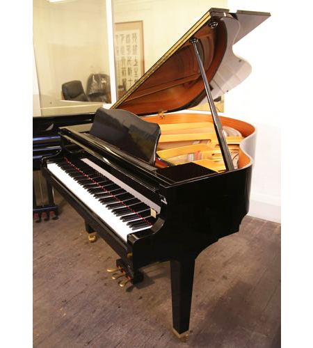 A 2000, Yamaha GA1 baby grand piano for sale with a black case and polyester finish