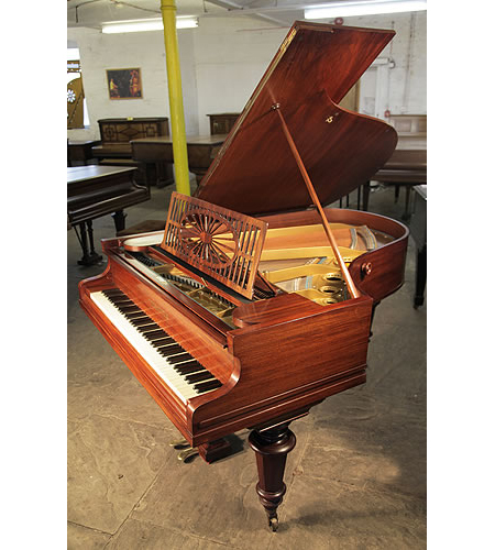 Bechstein Model A grand piano with a polished, rosewood case and turned legs