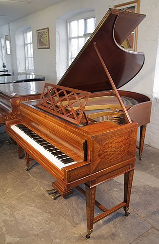 A Sheraton style, Bechstein Model V grand piano with a mahogany case and gate legs. Cabinet features walnut, satinwood and boxwood inlay.