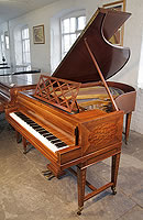 A Sheraton style, Bechstein Model V grand piano with a mahogany case and gate legs.