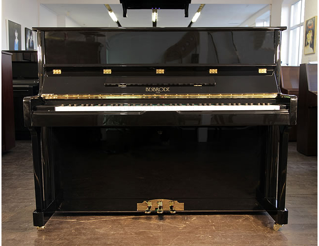 A Brand New Besbrode 118 upright piano with a black case