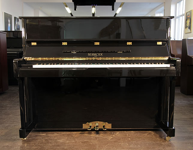 Brand New, Besbrode 118 upright Piano for sale with a black case.