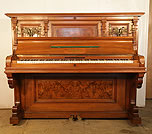 Piano for sale. An 1899, Bluthner upright piano with a  walnut case,burr walnut panels and carved pilasters