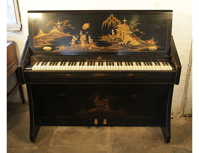 A 1935, Broadwood miniature upright grand piano with a black case, covered in Japanese paintings