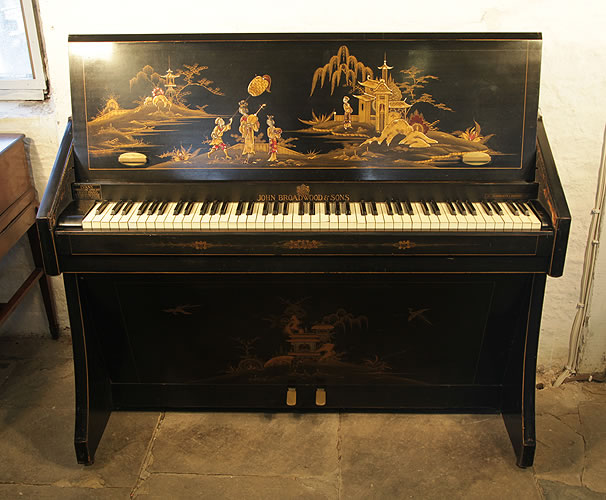 A 1935, Broadwood miniature upright grand piano with a black case, covered in Japanese paintings. Comes with matching piano stool. Piano has eighty-five notes and two pedals