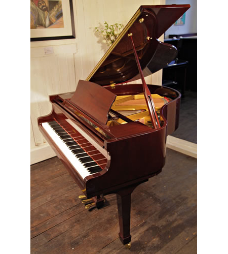 A Challen GP142 baby grand piano with a mahogany case and polyester finish