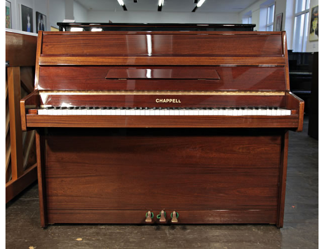 A Chappell upright piano with a walnut case and polyester finish