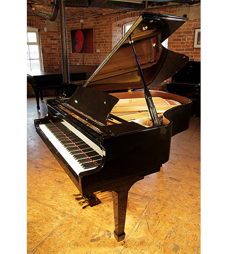 A pre-owned, 2009, Essex EGP173 grand piano with a black case and polyester finish