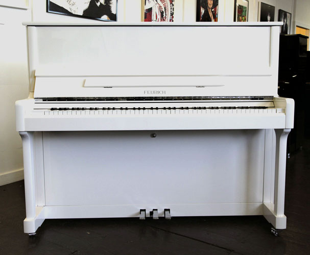 Brand New, Feurich Model 122 upright Piano for sale with a white case.