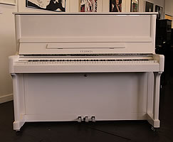 Feurich 122 upright piano with a white case and chrome fittings