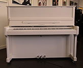 Piano for sale. A Feurich Model 122 upright piano with a white case.