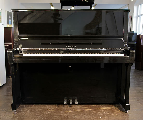 A brand new Feurich Model 133 concert upright piano with a black case and chrome fittings