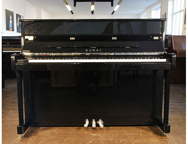 A Kawai K2 upright piano with a black pearl case and polyester finish
