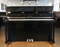 Kawai K2 upright piano with a black pearl case