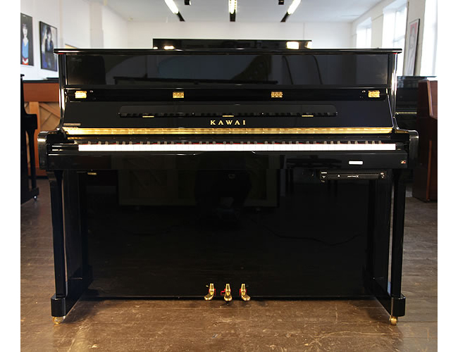 A Kawai K2 ATX upright piano with a black case and polyester finish. Piano has a fitted Anytime X silent system