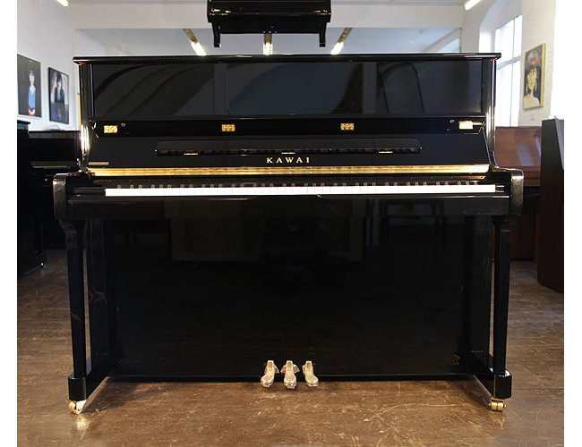A Kawai K3 upright piano with a black case and polyester finish