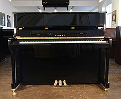 Kawai K3 upright piano with a black  case
