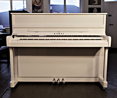 Kawai K2 upright piano with a white case