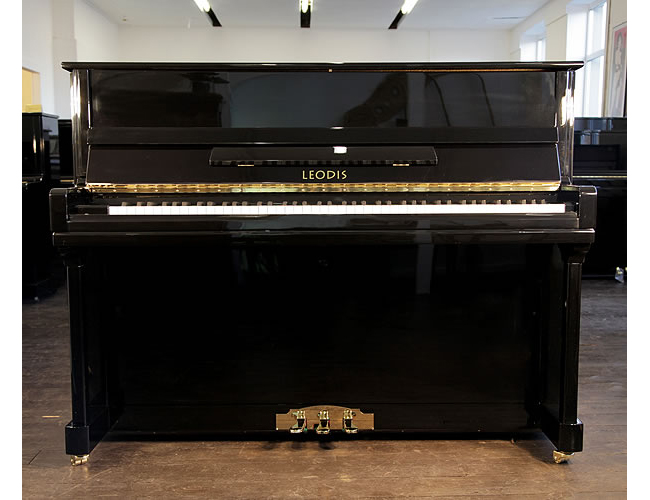 A Brand New Leodis 115 upright piano with a black case, three pedals and brass footplate