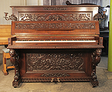 Piano for sale. A Mand upright piano with a neoclassical style case, covered in ornate carvings