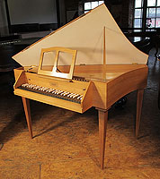 A Neupert spinet with a walnut case