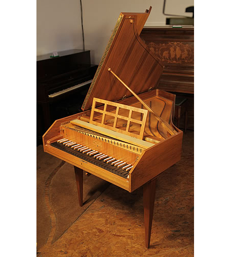 A 1970's Sperrhake Passau harpsichord with a satinwood case and boxwood stringing.