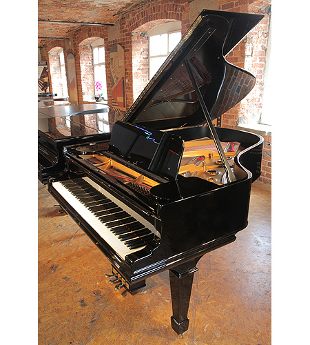 A rebuilt, 1901, Steinway Model A grand piano with a black case and spade legs