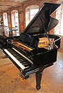 Piano for sale. A rebuilt, 1901, Steinway Model A grand piano with a black case.