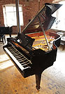 A 1999, Steinway Model A grand piano with a black case and spade legs.
