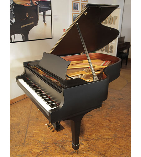 A 2000, Steinway Model A grand piano with a satin, black case and spade legs