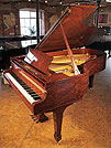 Piano for sale. A Steinway Model B grand piano with a bubinga case.