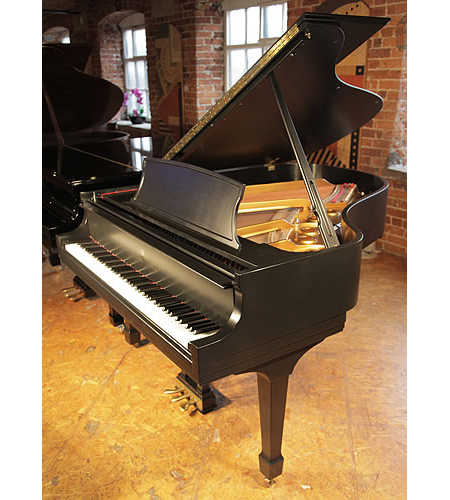 A 1995 Steinway Model L grand piano with a satin, black case