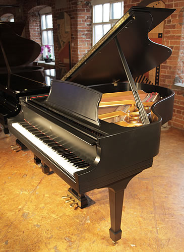 A 1995 Steinway Model L grand piano with a satin, black case and spade legs