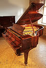 A Crown Jewels, Steinway Model M grand piano with an exquisite, flame mahogany case