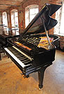 Piano for sale. A rebuilt, Steinway Model O grand piano with a black case.