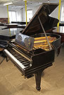 A 1920, Steinway Model O grand piano with an black case and cut-out music desk