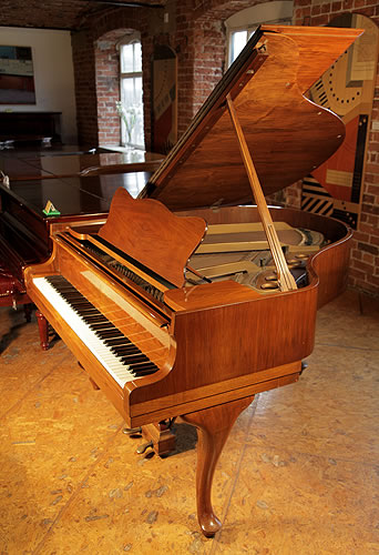 A 1938, Steinway Model S baby grand piano with a mirrored walnut case and cabriole legs