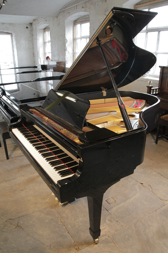 A Yamaha C3 grand piano for sale with a black case and polyester finish.