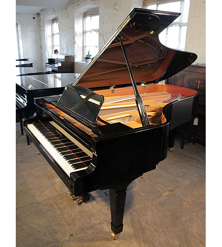 A 1990, Yamaha C3 grand piano for sale with a black case and spade legs