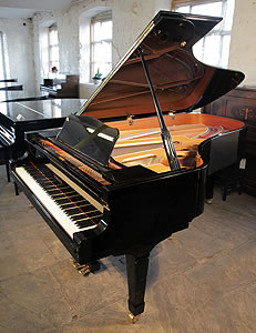 A Yamaha C7 grand piano for sale with a black case and polyester finish.